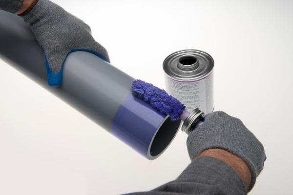 Applying primer to Corzan CPVC
