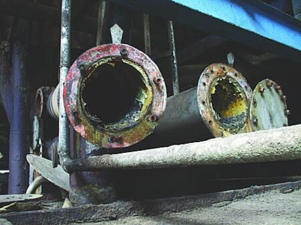 old badly scaled and corroded metal pipe