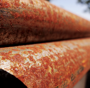 corrosion riddent rusty metal pipe